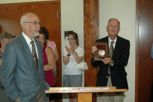 AppalCART Transportation Director gives Board Chair Jerry Moretz an award of appreciation for his service. Photo by Jesse Wood