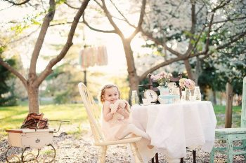 Kelly and Phil's daughter, Lily, is pictured in an outdoor set-up styled by A Bushel and a Peck. Photo by Nicole Holman Photography.