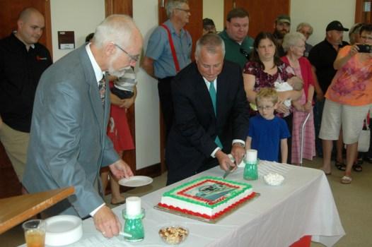NCDOT Secretary Tony Tata cuts the cake. Photo by Jesse Wood