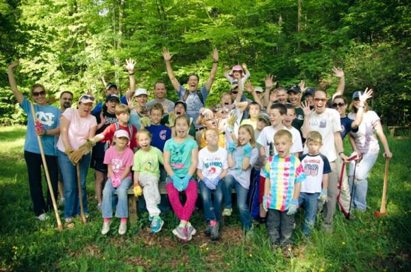 Scott, Cassey, and the amazing kids who turned a blown down, limb-strewn forest into a sanctuary. Photo courtesy Boone United Trail Facebook page