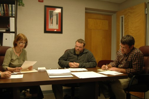 Campbell, Eggers and Aceto (left to right) at Tuesday's meeting inside the boardroom of the Watauga County Board of Elections. Photo by Jesse Wood