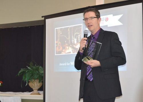 Town Manager Scott Fogleman accepts the chamber's award for Winter Wonderland Lighting on behalf of Memorial Park.