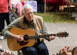 Incumbent Boone Town Council Candidate Rennie Brantz plays guitar at the Boone Heritage Festival in mid October. Photo by Lonnie Webster