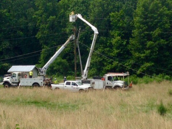 Linemen are restoring final 300 without power from Friday's storm: Sherwood, Sugar Grv, Bethel in Watauga Cnty. Courtesy BREMCO