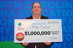 Mike Conrad with his check for $1 million. Photo submitted