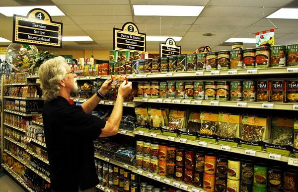 Ben Henderson is pictured at Bare Essentials Natural Market in Boone. Photo by Peter Morris for High Country Magazine.