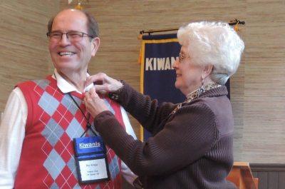 Marion Krege pins husband Roy during a Kiwanis Awards Ceremony