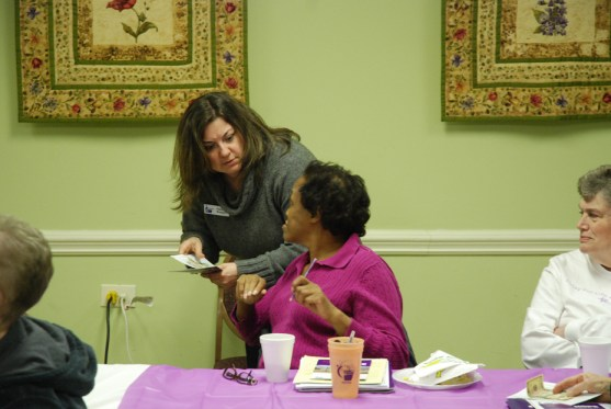 Bossert helps an attendee get signed up for Relay 2013.