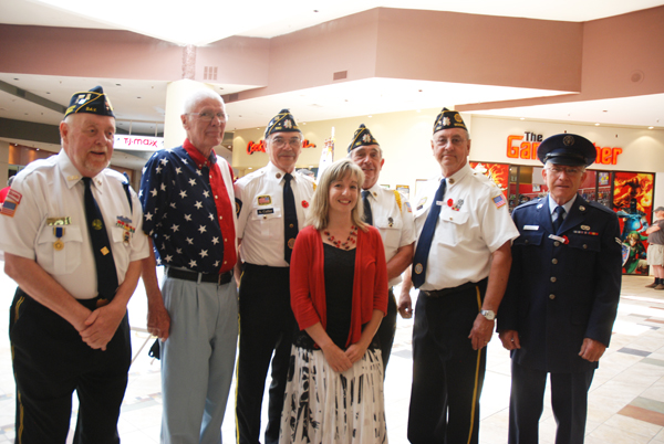 April Pope stands with several veterans at the ceremony in the Boone Mall.