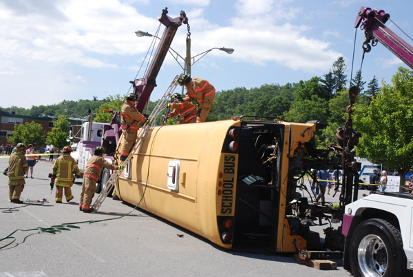 Firefighters enact an emergency situation involving a bus.