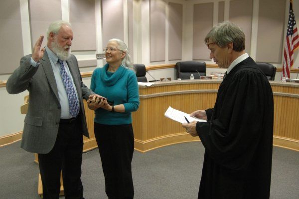 Democrat Commissioner Larry Turnbow, with his wife Marjory by his side, is sworn into office.