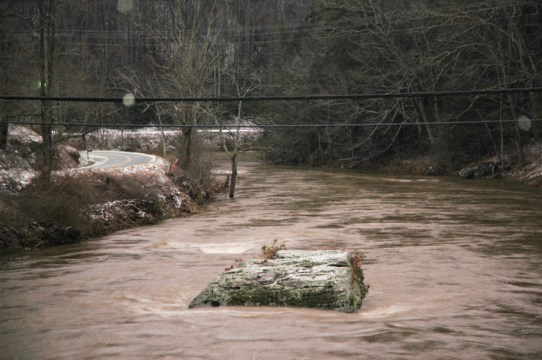 The Watauga River at the bridge on Rominger Road.  Normally, the entire boulder is visible. Before the flood on Wednesday, five more feet of this boulder was visible. Photo by Jesse Wood