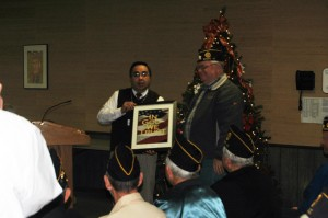 Fonseca accepts posters from American Legion at this month's school board meeting. Photo by Jesse Wood