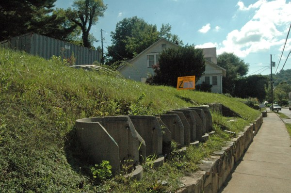 Owners of these two properties - the vacant lot and the white house - have requested they be rezoned. Photo by Jesse Wood