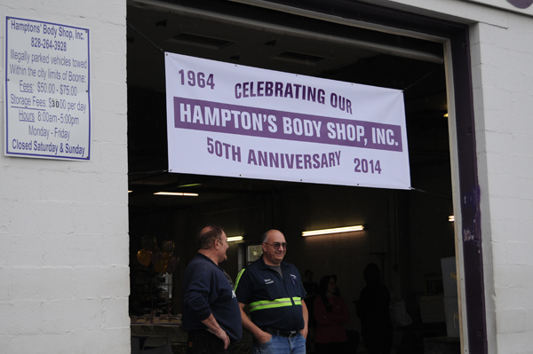 Employees of Hampton's Body Shop at the celebration on Friday.