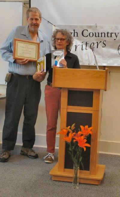 Doug Kaiser receives his Book of the Year award from Linda Jencson. Photo by Ree Strawsman.