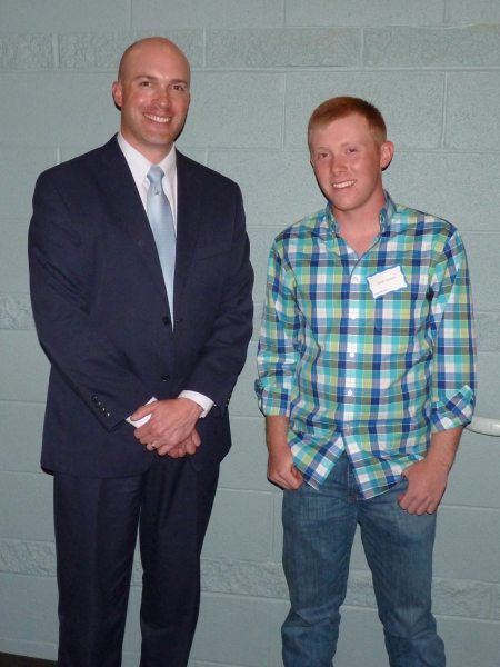 Dr. Elliott is shown with Watauga High School student Devin Hollars, first place winner of the state level SkillsUSA carpentry competition.