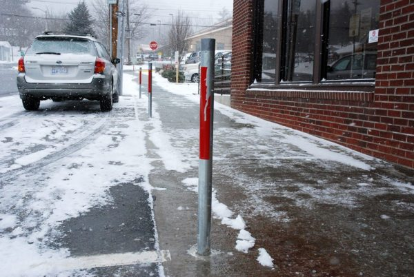 As seen on Depot Street, poles for the parking meters have been installed. Full implementation of metered parking in Boone is still two to three months away. Photo by Ken Ketchie