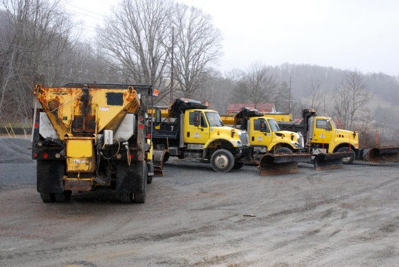 NCDOT trucks are ready to battle the winter weather on Wednesday. Photo by Ken Ketchie