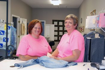 Nicole Wagoner (left) and Sharon Crump (right), seamstresses for C.W. Alterations. Photo by Ken Ketchie