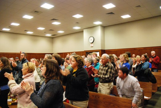 Those supporting the novel  being taught in Watauga High School applaud after Whitaker's presentation.