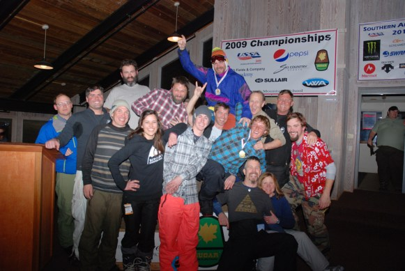 The snowboard teams - Last Run Lounge, Edge of the World, Modern Rustic and Scotland Yards - pose after the final SMARL race of 2012-13.