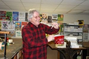 Kevin Conway, of SOS Printing, draws the winner for the first HCPress.com birthday giveaway. Photo by Ken Ketchie