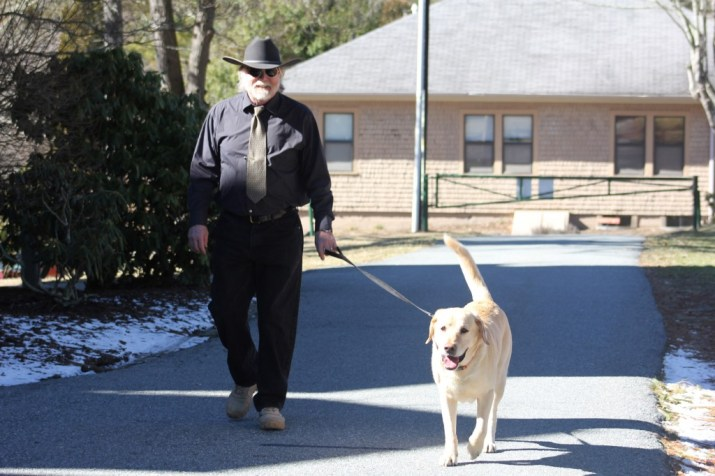 Dr. Joslin Walking on campus with his dog