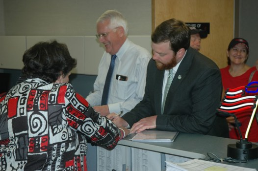In the foreground, Boone Town Council Member Andy Ball files his candidacy for Boone mayor on Friday. Rennie Brantz, also a current council member, files his candidacy for re-election as well. Photo by Jesse Wood