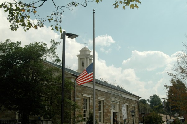 On the 12th anniversary of the 9/11attacks, the American flag flies half-mast at the downtown Boone post office. Photo by Jesse Wood