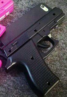 Glamzelle Gun-Shaped iPhone Case. Images from Glamzelle.com.