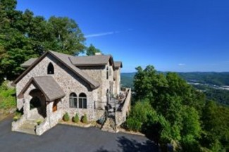 Dozens of tiny parcels are for sale as well as a 49-acre parcel that features this home.