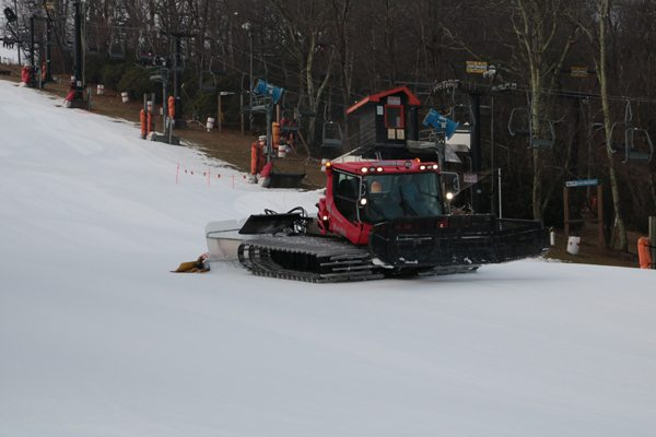 Appalachian Ski Mtn. grooming machines in action. The blades in the front push the snow, while the tiller in the back smooths out the snow to create the corduroy effect. Photo by Ric Wilkinson