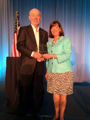 Jo Ann Emerson, right, chief executive officer of NRECA, presents the national CEO Communication Leadership Award to Doug Johnson, CEO of Blue Ridge Electric.