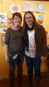 Charlotte Baxter, owner of Shear Shakti hair salon, and Kelly Snyder, art teacher at Two Rivers Community School, stand in front of some of the art that was on display throughout the month of March. Photo submitted