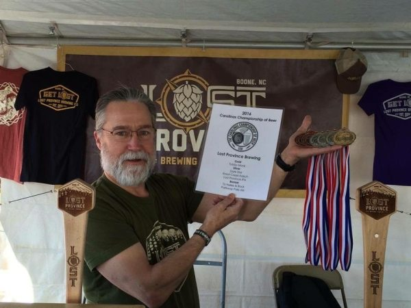 Andy Mason shows off medals earned by Lost Province Brewing Co.