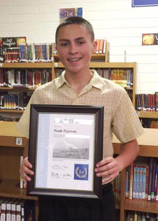 Noah Pearson with his award