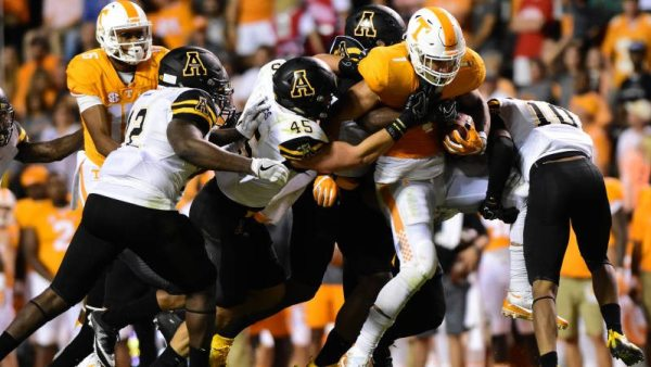 The Mountaineers converge on a Tennessee running back in the season opener. Photo courtesy App State Athletics