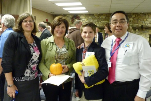 From left: Valle Crucis Principal Martha Clark; Melanie Bullard, mother of Mac Waters; Mac Waters; Superintendent Dr. David Fonseca