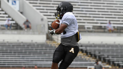 Freshman running back Marcus Cox hauls in a pass during practice at Kidd Brewer Stadium. Photo by Tyler Buckwell, Courtesy of App State Sports