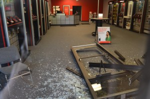 Damage caused when a vehicle was driven into the storefront two weeks ago. Photo by Mark S. Kenna