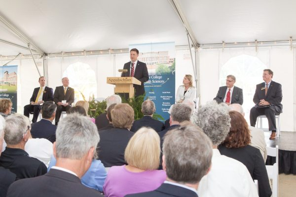 Andrew T. Heath, budget director for the State of North Carolina, speaks on behalf of Gov. Pat McCrory to attendees at the June 23 groundbreaking of the Beaver College of Health Sciences building. With him on the dais are, from left, Appalachian's Provost Darrell Kruger, Appalachian Regional Healthcare System President and CEO Richard Sparks, Chancellor Sheri N. Everts, Donald C. Beaver and Dean Frederick K. Whitt.