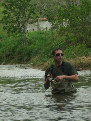 A man fishes on the Watauga River in Valle Crucis. Photo by Jesse Wood