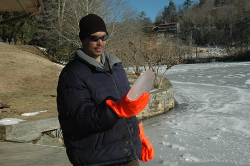 Mike Nathan holding a three-inch thick chunk of ice