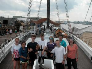 Group photo of Rolling Academy on a Boat in Gloucester, Mass.