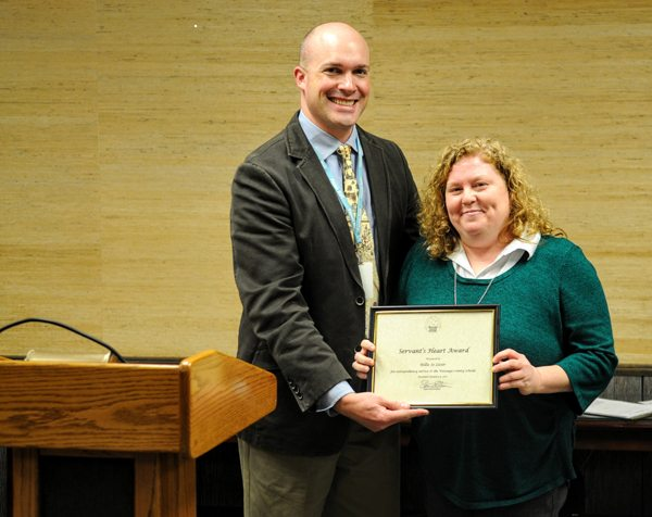 WCS Superintendent Dr. Scott Elliott presents Lister with the Servant's Heart Award. Elliott thanked Lister for her hard work in the central office and her service to the system's Extended Learning Program.