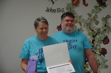 Co-chairs Kathy Idol and Brian Barker hold Idol's award