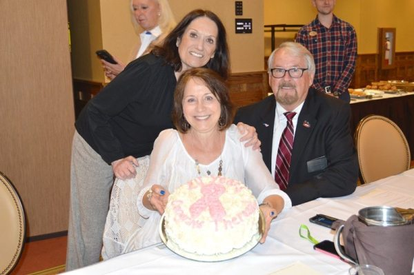 Chetola's Marcia Greene surprises Theresa King, wife of Shriner Potentate Johnny King, with a cake to celebrate her 24 years of being cancer free.