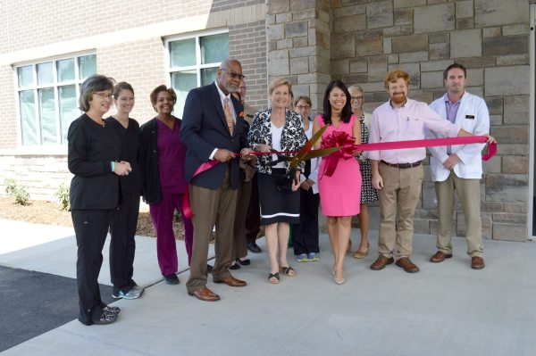 Graystone Eye President and CEO Sheree Watson (center) is pictured with members of the Graystone Eye team at Monday's ribbon cutting. Dr. Joseph Allen, Jr. is pictured to Watson's left. Dr. Gabriela Rodriguez is pictured to her right, standing next to Boone Chamber President and CEO David Jackson.