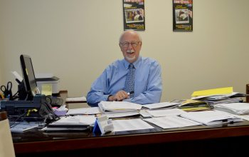 HCUW Executive Director Gary Childers is pictured working at his desk in the HCUW offices.